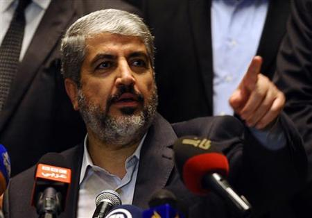 Hamas leader in exile Khaled Meshaal speaks during a news conference in Cairo, November 21, 2012. REUTERS/Mohamed Abd El Ghany/Files