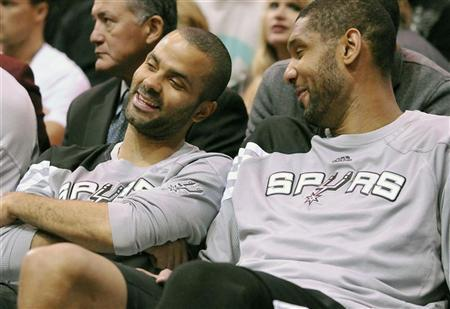 San Antonio Spurs point guard Tony Parker (L) and center Tim Duncan talk on the bench during the second half of their NBA basketball game against the Utah Jazz in Salt Lake City, Utah, May 7, 2012. REUTERS/Eli Lucero