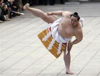 Mongolian-born grand sumo champion Yokozuna Asashoryu, wearing a ceremonial belly band, performs a ring-entering ritual at Meiji Shrine in Tokyo in this January 6, 2010 file photograph. With a history spanning centuries, sumo once graced the Imperial courts of Japan and wrestlers were held in the highest regard. Sponsors lavished gifts on the hulking giants and to join the ranks of the sumo was considered a worthy occupation. Those days are long gone, however. Tarnished by scandals involving drug use, bout-fixing, violence and alleged links to Japanese organised crime, sumo struggles to fill stadiums and attract new fans. REUTERS/Issei Kato/Files