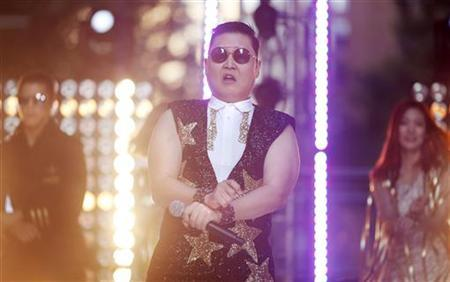 South Korean singer Psy performs his hit ''Gangnam Style'' during a morning television appearance in central Sydney October 17, 2012. REUTERS/Tim Wimborne/Files