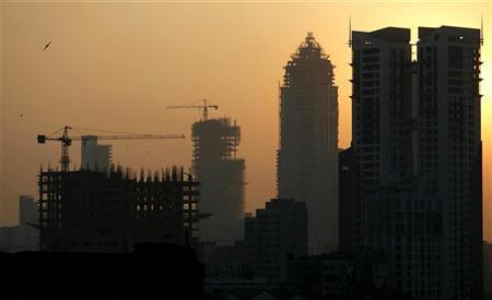 Buildings under construction are seen under the Mumbai skyline November 23, 2008. REUTERS/Arko Datta/Files