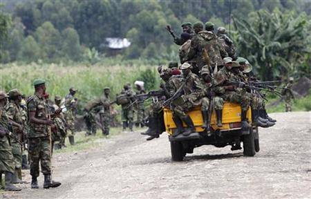 M23 rebel fighters sit on a truck as they withdraw near the town of Sake, 42 km (26 miles) west of Goma in eastern Congo November 30, 2012. REUTERS/James Akena/Files
