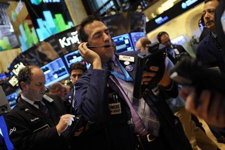 Traders work on the floor of the New York Stock Exchange in New York, November 30, 2012. REUTERS/Keith Bedford