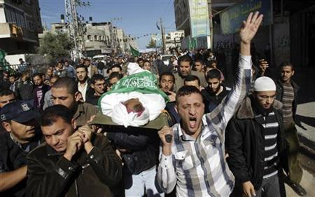 Palestinians carry the body of Hussam al-Hams, a member of Hamas' security forces, during his funeral in Rafah, in the southern Gaza Strip November 30, 2012. Al-Hams died on Thursday of a wound he suffered from an Israeli air strike during an eight-day cross-border violence, Palestinian medics said. Eight days of Israeli air strikes on Gaza and cross-border Palestinian rocket attacks ended in an Egyptian-brokered truce agreement that called on Israel to ease restrictions on the territory. REUTERS/Ibraheem Abu Mustafa (GAZA - Tags: POLITICS CIVIL UNREST)