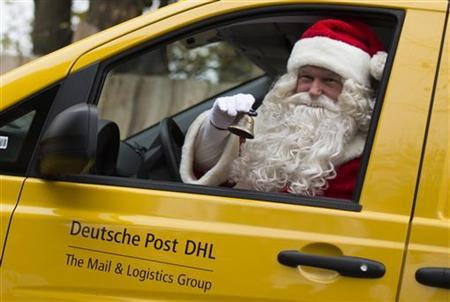 A man dressed as Santa Claus arrives at the post office in a electro-powered van in the village of Himmelpfort, November 9, 2012. Germany's Deutsche Post postal service opened on Friday its official Christmas Post Office that answers letters to Santa Claus sent by children from over 80 countries. In 2011 local volunteers at the post office in Himmelpfort, which translates as Heaven's Gate, replied to some 300,000 letters in 18 languages, a press release said. REUTERS/Thomas Peter (GERMANY - Tags: SOCIETY)