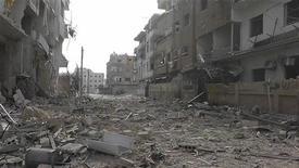 Prédios danificados são vistos após mísseis atingirem a região de Daria, perto de Damasco, Síria. Aviões sírios bombardearam regiões de Damasco controladas por rebeldes neste sábado, disseram moradores, e um apagão nacional na internet entrou em seu terceiro dia. 30/11/2012 REUTERS/Kenan Al-Derani/Shaam News Network/Handout