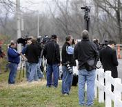 Kansas City media cover the scene of an apparent suicide of Kansas City Chiefs linebacker Jovan Belcher, who earlier shot and killed his girlfriend elsewhere in Kansas City Missouri December 1, 2012. REUTERS/Dave Kaup
