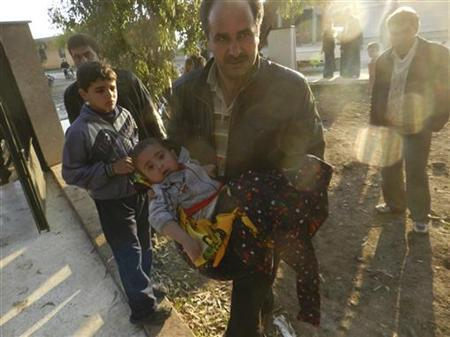 A man carries his baby girl, whom activists said was injured by shelling by forces loyal to Syria's President Bashar al-Assad, at a makeshift hospital in Houla, near Homs, December 2, 2012. REUTERS/Misra Al-Misri/Shaam News Network/Handout