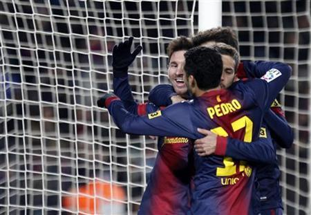 Barcelona's Lionel Messi celebrates his second goal with team mates against Athletic Bilbao during their Spanish first division soccer match at Nou Camp stadium in Barcelona December 1, 2012. REUTERS/Gustau Nacarino