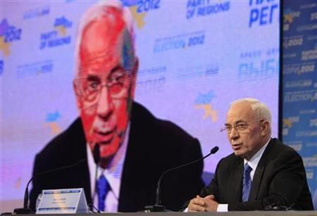 Ukraine's Prime Minister Mykola Azarov addresses the audience at the pro-President Yanukovich Regions Party's election headquarters in Kiev, October 28, 2012. REUTERS/Anatolii Stepanov/Files