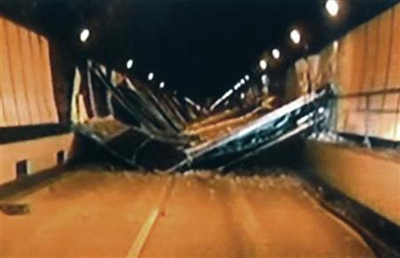 Broken concrete ceiling panels are seen after collapsing inside Sasago Tunnel on the Chuo Expressway in Yamanashi Prefecture, in this handout still image taken from video by Yamanashi Prefectural Police on December 2, 2012, and released by Kyodo December 3, 2012. REUTERS/Kyodo
