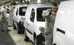 French carmaker Renault employees work on a Renault Kangoo van assembly line at the Renault factory in Maubeuge, northern France, October 8, 2012. REUTERS/Pascal Rossignol