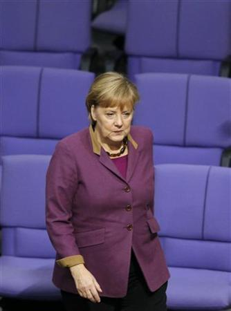 German Chancellor Angela Merkel makes her way to vote on financial help for Greece at the lower house of parliament, the Bundestag, in Berlin November 30, 2012. REUTERS/Wolfgang Rattay