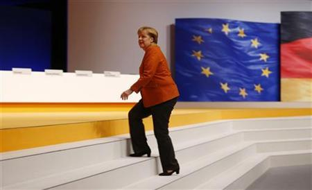 German Chancellor and leader of Germany's Christian Democratic Union (CDU), Angela Merkel arrives to inspect the convention hall one day ahead of the CDU's annual party meeting in Hanover, December 3, 2012. REUTERS/Kai Pfaffenbach (GERMANY - Tags: POLITICS)