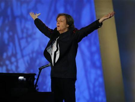 Musician Paul McCartney performs during the opening ceremony of the London 2012 Olympic Games at the Olympic Stadium July 27, 2012. REUTERS/Mike Blake/Files