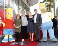 "Matt Groening, creator of ""The Simpsons,"" (3rd L) poses on his star with voice actors Nancy Cartwright (2nd L), Hank Azaria (2nd R), Yeardley Smith (3rd R) and characters Homer (R) and Bart Simpson after the star was unveiled on the Walk of Fame in Hollywood, California February 14, 2012. Cartwright, Azaria and Smith are the voices of various characters in ""The Simpsons"". REUTERS/Mario Anzuoni"