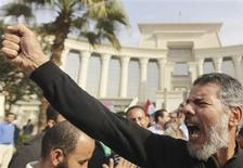 A supporter of Egypt's President Mohamed Mursi gestures during a rally in front of the Supreme Constitutional Court in Maadi, south of Cairo, December 2, 2012. REUTERS/Amr Abdallah Dalsh