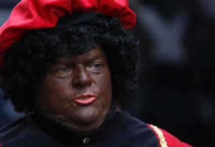 A woman dressed as 'Zwarte Piet' (Black Pete), the helper of Saint Nicholas, is seen during a traditional parade in central Brussels December 1, 2012. REUTERS-Francois Lenoir