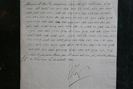 A rare letter written in code by French Emperor Napoleon Bonaparte during his Russian military campaign is displayed at a Paris auction house, November 22, 2012. REUTERS/Charles Platiau