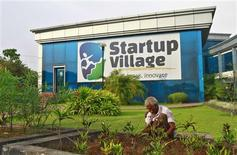 A gardener plants seedlings at the entrance of Start-up Village in Kinfra High Tech Park in the southern Indian city of Kochi October 13, 2012. REUTERS/Sivaram V
