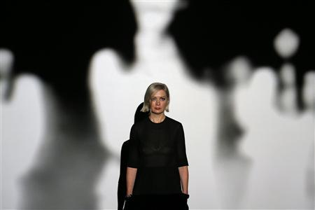 Artist Elizabeth Price poses for a photograph in front of her video installation 'THE WOOLWORTHS CHOIR OF 1979' after winning Britain's Turner Prize at Tate Britain in London, December 3, 2012. British video artist Elizabeth Price won the coveted Turner Prize for contemporary art on Monday, delighting critics who had championed her film about a fatal fire in Manchester in 1979, describing it variously as ''terrifying'' and ''exhilarating''. REUTERS/Stefan Wermuth