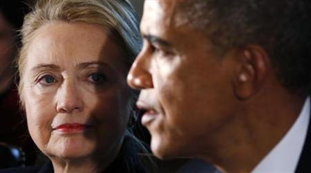 U.S. Secretary of State Hillary Clinton (L) listens to U.S. President Barack Obama speak during a meeting with members of his cabinet at the White House in Washington November 28, 2012. REUTERS/Kevin Lamarque