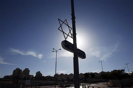 Israel says will stick with settlement plan despite condemnation
