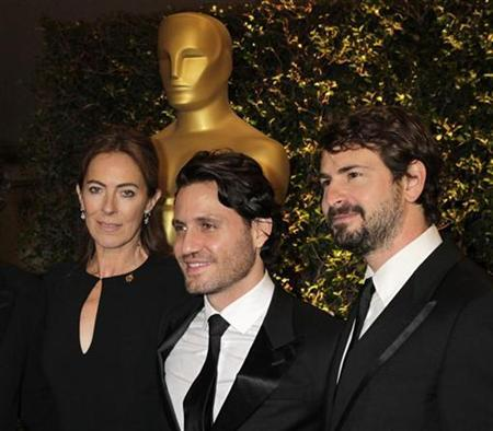 Director Kathryn Bigelow, who won an Oscar for the movie ''The Hurt Locker'' and whose current film ''Zero Dark Thirty'' is about the U.S. operation to kill Osama bin Laden, arrives with Venezuelan actor Edgar Ramirez (C) and screenwriter Mark Boal at the Academy of Motion Picture Arts & Sciences 4th annual Governors Awards in Hollywood December 1, 2012. REUTERS/Fred Prouser