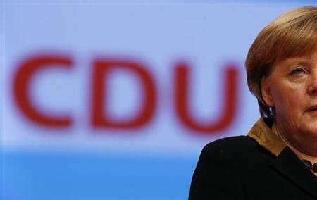 German Chancellor and leader of Germany's Christian Democratic Union (CDU), Angela Merkel delivers her speech at the CDU's annual party meeting in Hanover, December 4, 2012. 1001 delegates are expected to elect party leader and German Chancellor Angela Merkel as top candidate for Germany's 2013 general elections during the three day party convention. REUTERS/Kai Pfaffenbach (GERMANY - Tags: POLITICS)