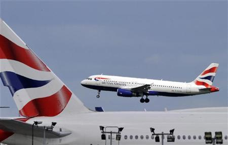 A British Airways plane flies into Heathrow Airport in west London May 12, 2011. REUTERS/Toby Melville