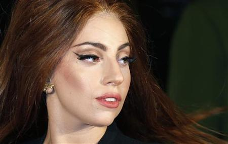 Lady Gaga arrives for the UK launch of her new fragrance ''Fame'' outside Harrods in London October 7, 2012. REUTERS/Suzanne Plunkett