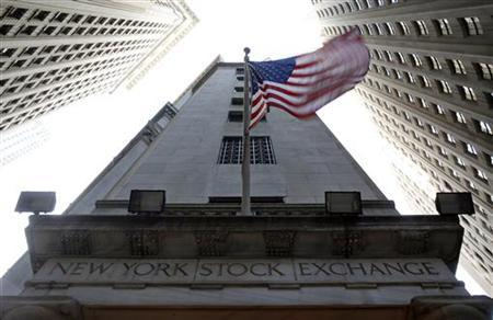 The U.S. flag waves in the breeze above one of the entrances to the New York Stock Exchange, November 19, 2012. REUTERS/Chip East