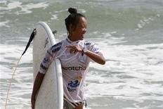 China's Darci Liu is pictured after her heat at the Swatch Girls Pro China surfing competition in Wanning, Hainan Island October 26, 2011. REUTERS/Will Swanton