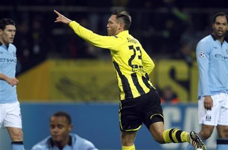 Borussia Dortmund's Julian Schieber (C) celebrates a goal against Manchester City during their Champions League group D soccer match in Dortmund December 4, 2012. REUTERS/Ina Fassbender