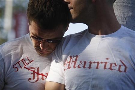 A gay couple hug as they celebrate their one-year wedding anniversary in West Hollywood, California, June 16, 2009. REUTERS/Lucy Nicholson