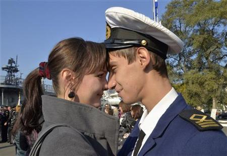 A woman meets her friend, a cadet from the Russian sailing vessel Pallada, named after the Greek goddess Pallas Athena, after his return to the far eastern city of Vladivostok October 8, 2011. REUTERS/Yuri Maltsev/Files