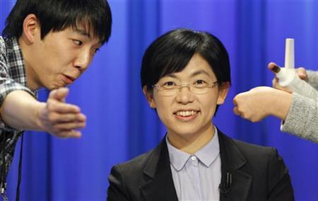 South Korea's presidential candidate Lee Jung-hee (C) of opposition Unified Progressive Party, talks with a staff member of a TV station before a televised debate in Seoul December 4, 2012. REUTERS/Lee Jae-Won