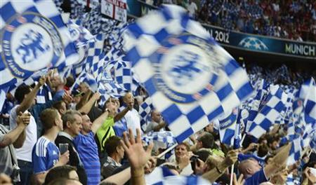 Supporters of Chelsea wave flags as they party before the start of the Champions League final soccer match between Chelsea and Bayern Munich at the Allianz Arena in Munich, May 19, 2012. REUTERS/Dylan Martinez