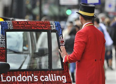 A doorman closes a taxi door outside a hotel in central London September 5, 2011. REUTERS/Toby Melville