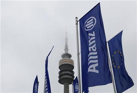 German insurer Allianz flags are seen in front of Munich's radio tower 'Olympiaturm' before the company's annual shareholders' meeting in Munich May 5, 2010. REUTERS/Michaela Rehle (GERMANY - Tags: BUSINESS)