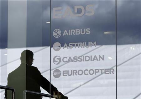 A visitor stands at the EADS booth during the ILA Berlin Air Show in Selchow near Schoenefeld south of Berlin, September 13, 2012. REUTERS/Tobias Schwarz
