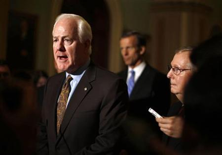 U.S. Senate Minority Leader Mitch McConnell (R-KY)(R) watches as John Cornyn (R-TX) speaks to the press on Capitol Hill in Washington, November 14, 2012. REUTERS/Jason Reed