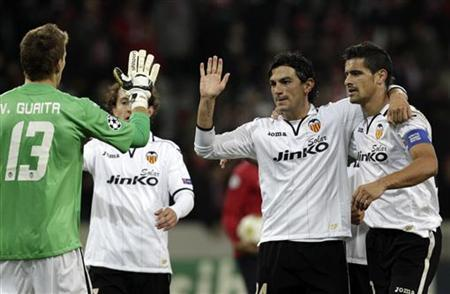 (L to R) Valencia's Vicente Guaita, Andres Guardado, Tino Costa and Ricardo Costa celebrate after defeating Lille in their Champions League soccer match at Lille Grand Stade in Villeneuve d'Ascq, December 05, 2012. REUTERS/Pascal Rossignol
