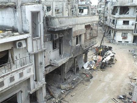 Damaged buildings are seen along a street in the al-Khalidiya neighbourhood of Homs December 5, 2012. REUTERS/Yazan Homsy