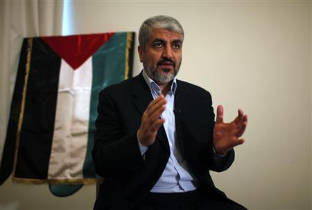 Hamas leader Khaled Meshaal speaks during his interview with Reuters in Doha November 29, 2012. Picture taken November 29, 2012. Meshaal is due to make his first visit to the Gaza Strip on December 7, 2012 for a two-day stay to join celebrations for Hamas's 25th anniversary and to take part in what the militant group says will be a victory rally after its recent conflict with Israel. REUTERS/Ahmed Jadallah/Files