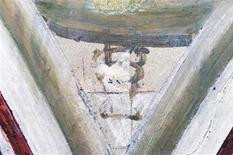 A close-up showing the section where the initials B (top) and G (bottom) were found in a part of a triptych, indicating his surname, Giotto di Bondone, in the lower basilica of St Francis in Assisi, in this handout picture dated June 22, 2012. REUTERS/Handout