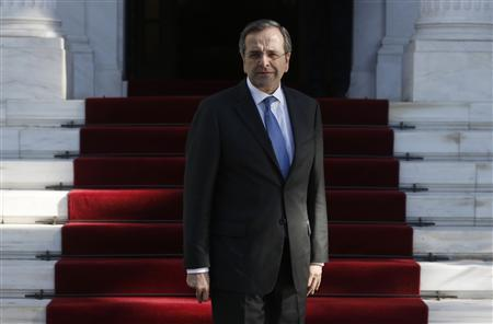 Greece's Prime Minister Antonis Samaras waits for Lebanon's President Michel Sleiman in Athens December 6, 2012. REUTERS/John Kolesidis