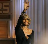 """Singer Whitney Houston waves at the taping of """"25 Strong: The BET Silver anniversary celebration"""" at the Shrine auditorium in Los Angeles on October 26, 2005. REUTERS/Mario Anzuoni"""
