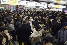 Passengers gather after train services were suspended following an earthquake at Sendai station in Sendai, Miyagi prefecture, in this photo taken by Kyodo December 7, 2012. REUTERS/Kyodo