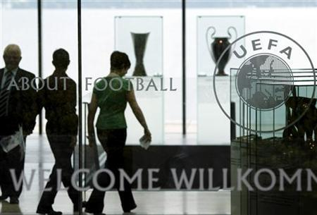 Staff are pictured in the entrance of UEFA in Nyon May 27, 2010. REUTERS/Denis Balibouse/Files